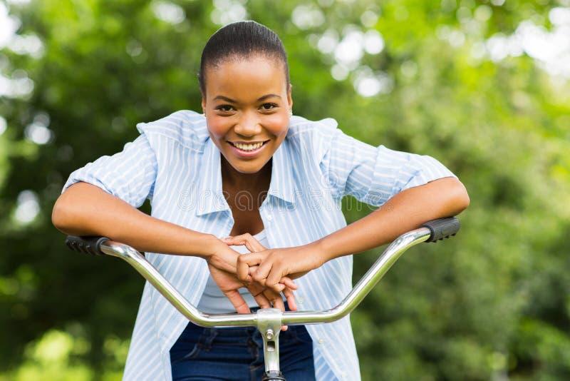 Muchacha africana en una bici fotos de archivo libres de regalías