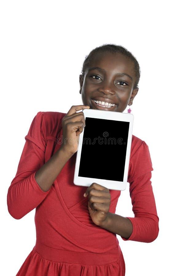 Muchacha africana que muestra el Tablet PC, espacio de la copia libre imagen de archivo libre de regalías