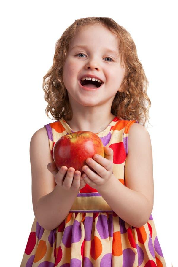 Muchacha alegre feliz con una manzana madura fotografía de archivo