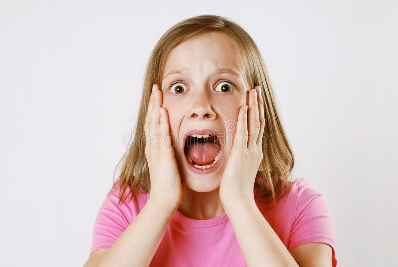 Muchacha asustada foto de archivo
