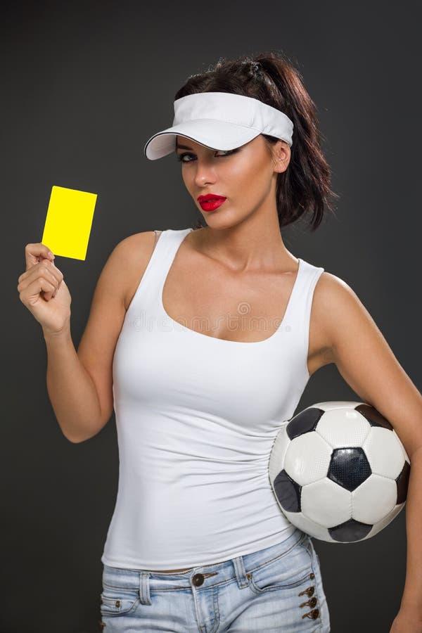 Muchacha atractiva con un balón de fútbol fotografía de archivo libre de regalías