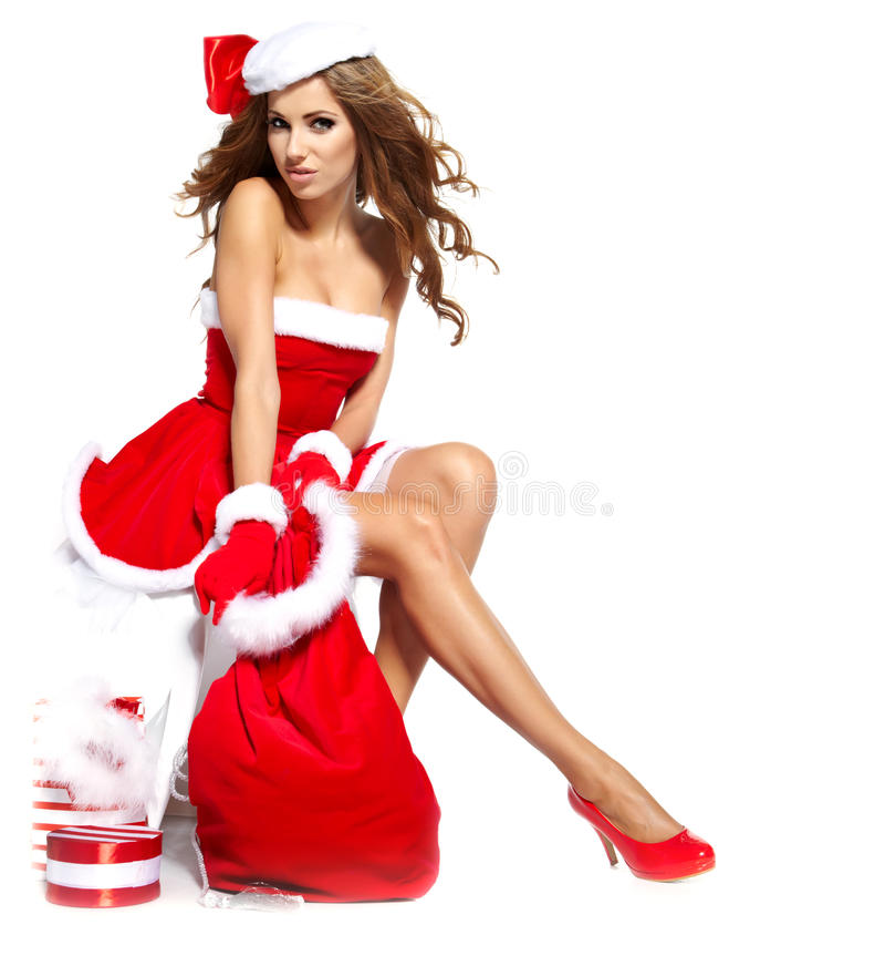 Muchacha atractiva hermosa que desgasta la ropa de Papá Noel imágenes de archivo libres de regalías