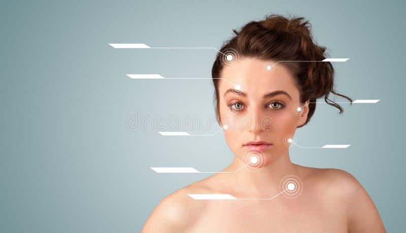 Muchacha atractiva joven con las flechas modernas del tratamiento facial imágenes de archivo libres de regalías