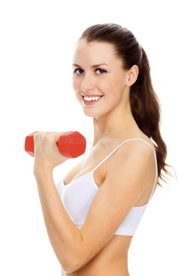 Muchacha bonita con el barbell rojo imagen de archivo libre de regalías