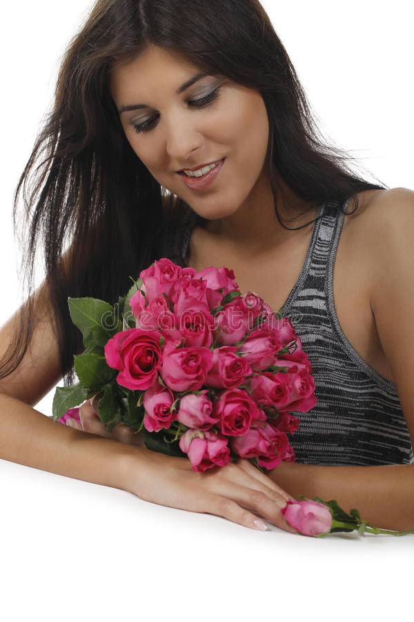Muchacha bonita con las rosas foto de archivo