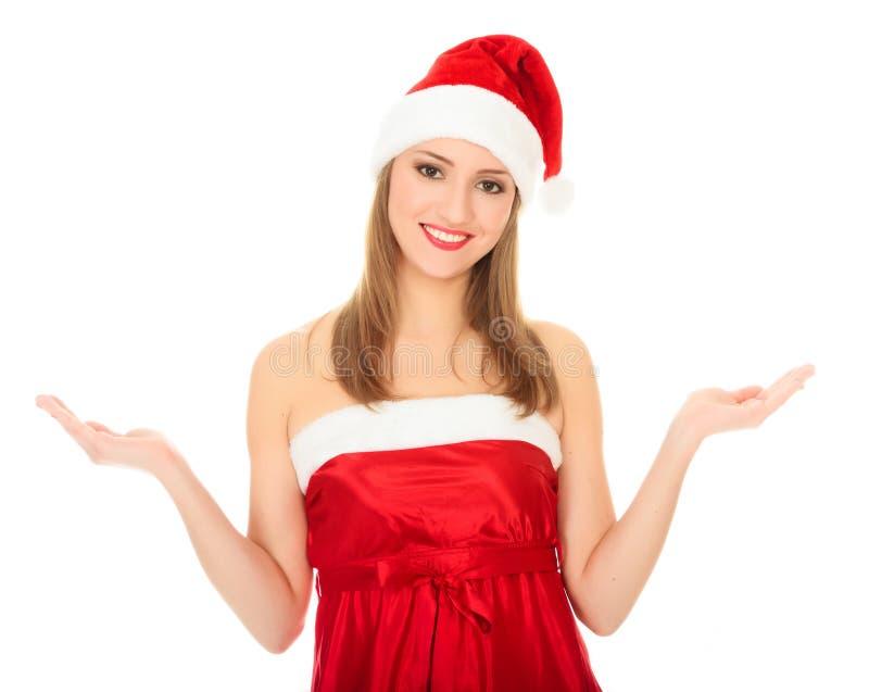 Muchacha bonita de la Navidad que detiene su palma de las manos. fotos de archivo libres de regalías