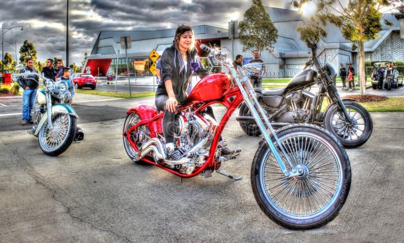 Muchacha bonita en la moto fotos de archivo libres de regalías