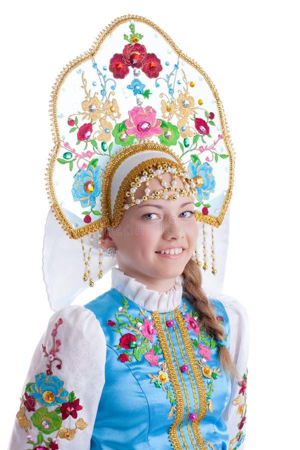 Muchacha bonita en traje ruso azul imágenes de archivo libres de regalías