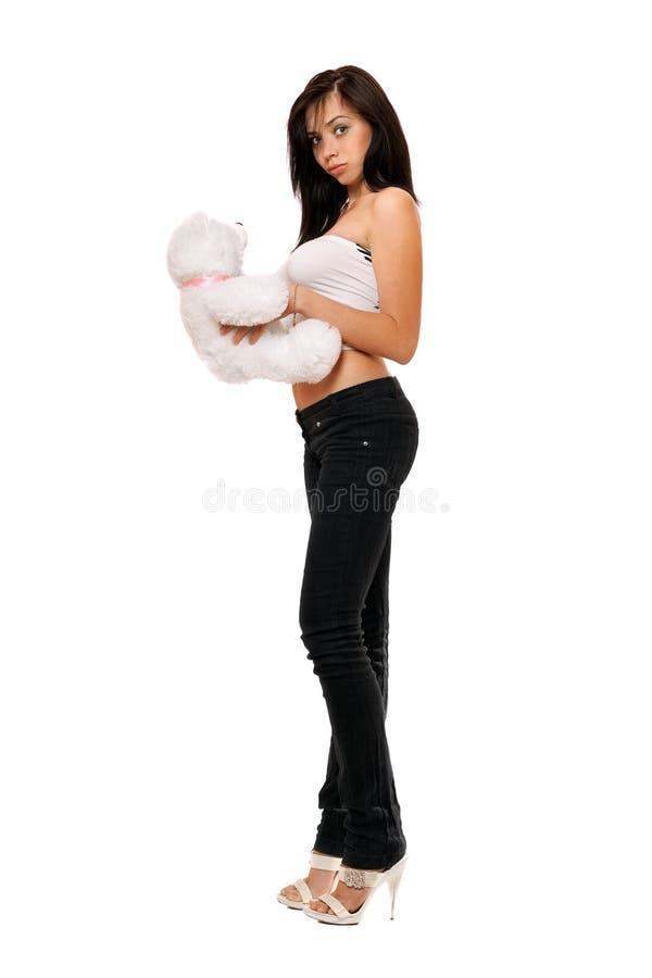 Muchacha bonita sorprendida con un teddybear fotografía de archivo