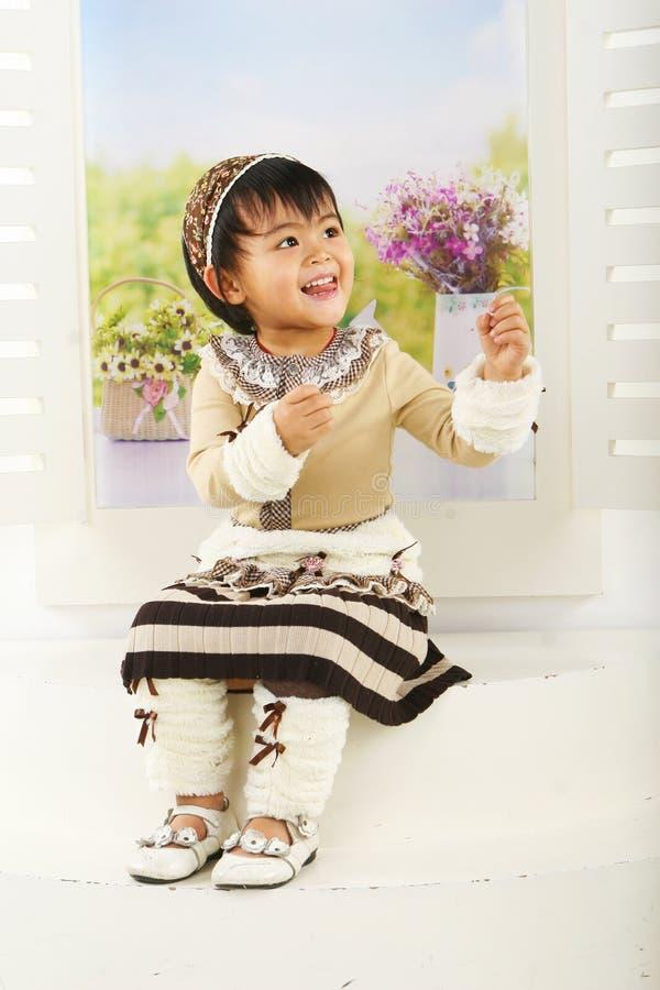Muchacha china encantadora foto de archivo libre de regalías
