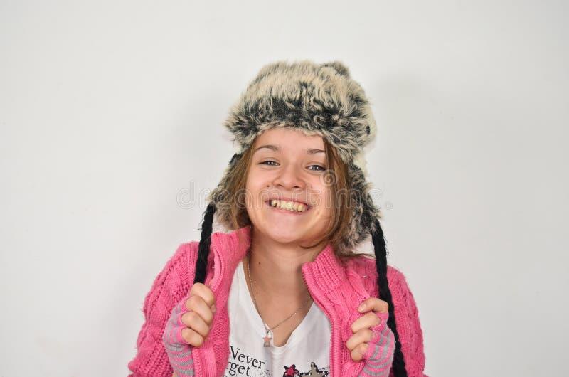 Muchacha cobarde con un sombrero divertido imagen de archivo libre de regalías