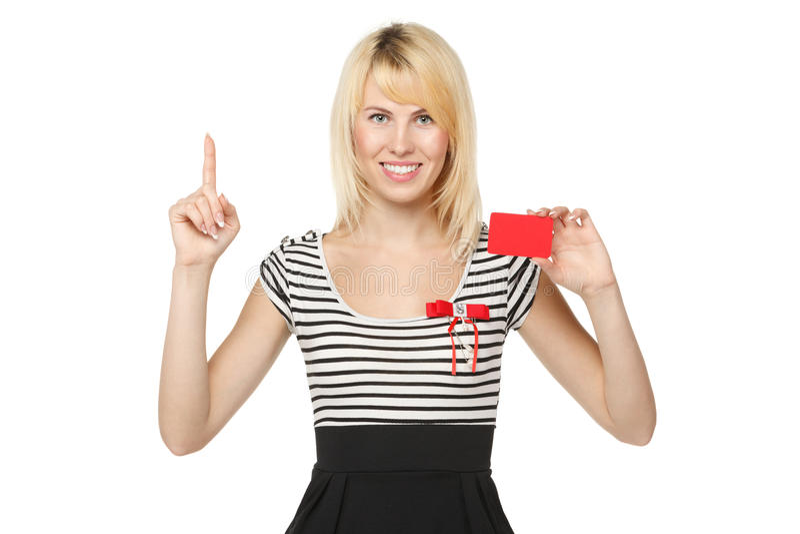 Muchacha con de la tarjeta de crédito en blanco fotografía de archivo
