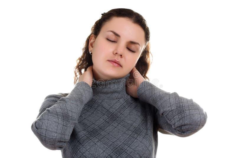Muchacha con dolor en el cuello fotografía de archivo