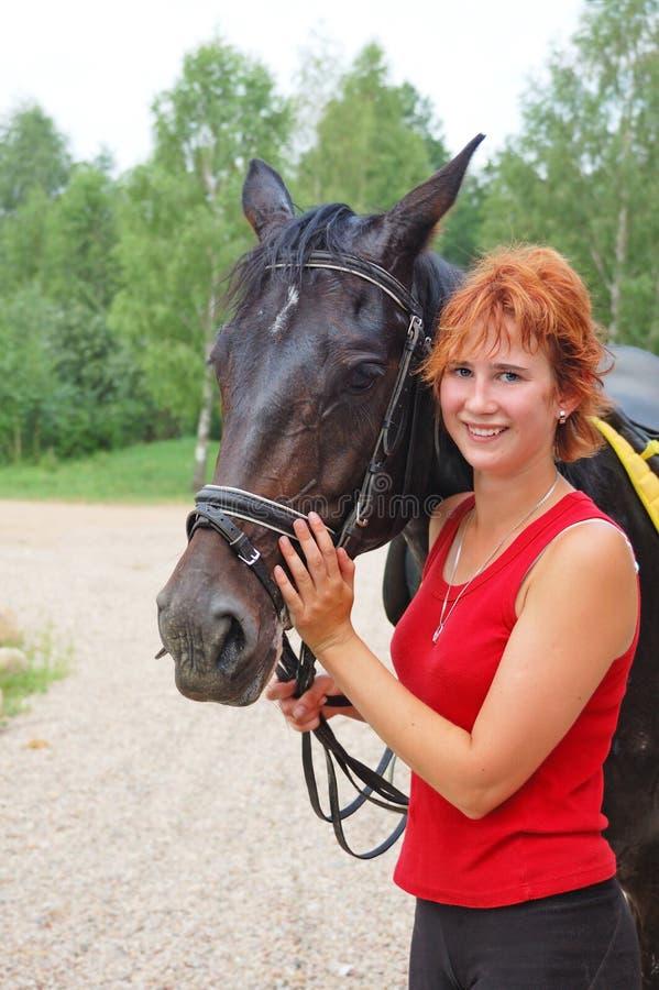 Muchacha con el caballo fotografía de archivo libre de regalías