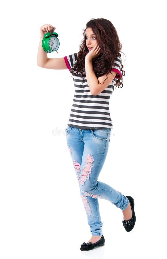 Muchacha con el despertador fotografía de archivo