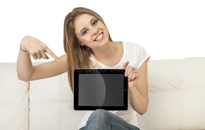 Muchacha con el dispositivo foto de archivo libre de regalías