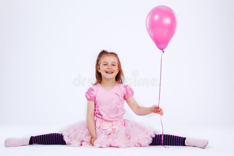 Muchacha con el globo fotos de archivo