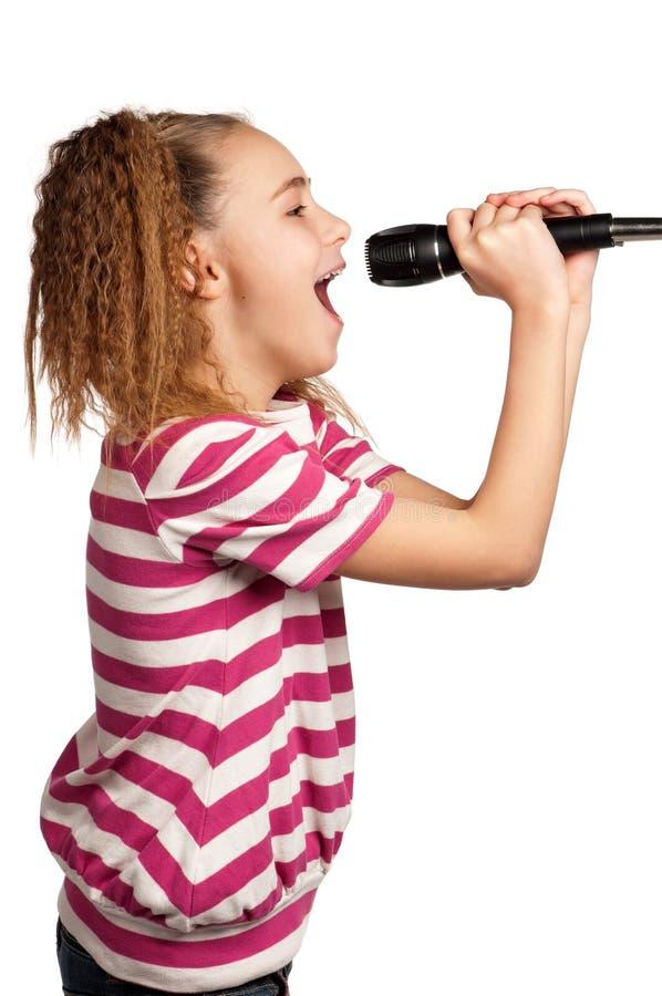 Muchacha con el micrófono imagenes de archivo