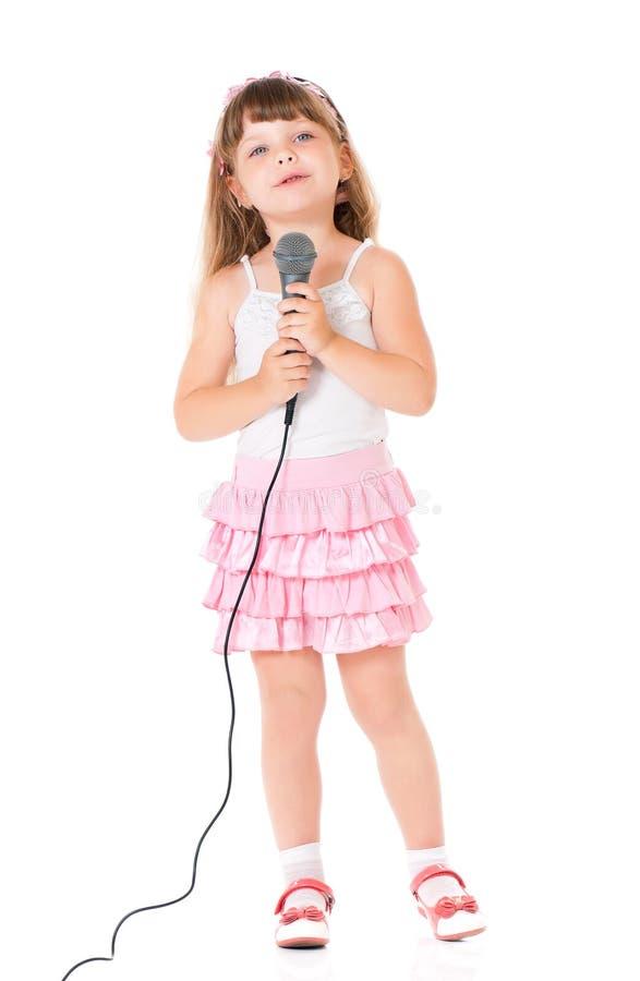 Muchacha con el micrófono imagen de archivo libre de regalías