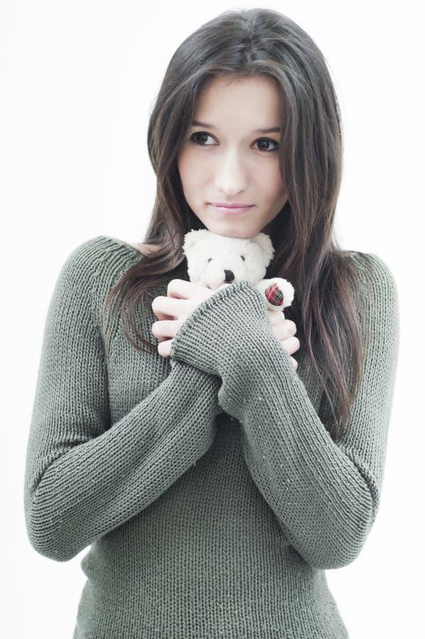 Muchacha con el oso de peluche foto de archivo libre de regalías
