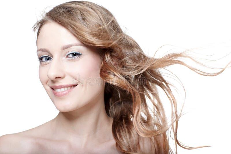 Muchacha con el pelo que agita fotos de archivo