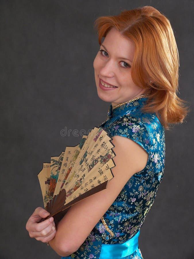 Muchacha con el ventilador foto de archivo libre de regalías