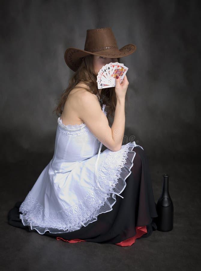Muchacha con jugar-tarjetas a disposición fotografía de archivo libre de regalías