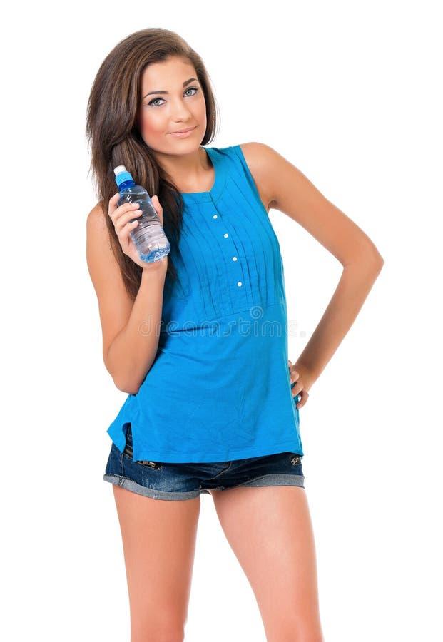 Muchacha con la botella de agua imagen de archivo libre de regalías