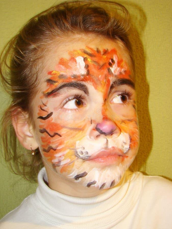 Muchacha con la cara del tigre foto de archivo
