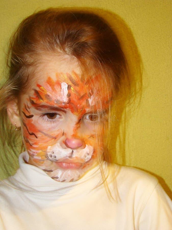 Muchacha con la cara del tigre imagen de archivo
