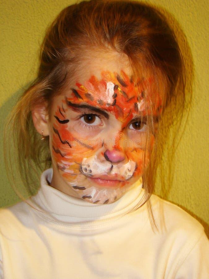 Muchacha con la cara del tigre fotografía de archivo libre de regalías