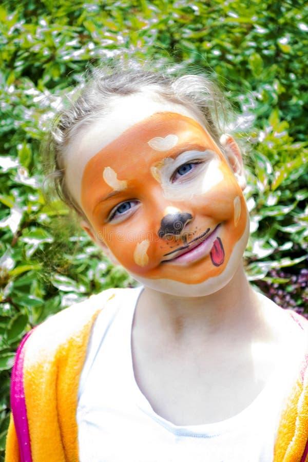 Muchacha con la cara pintada fotos de archivo