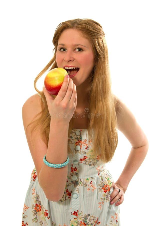 Muchacha con la manzana imagenes de archivo