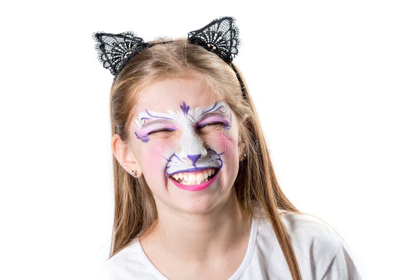 Muchacha con la pintura de la cara si un tigre foto de archivo