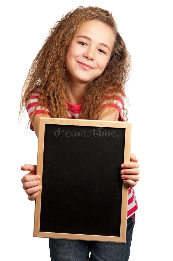 Muchacha con la pizarra foto de archivo