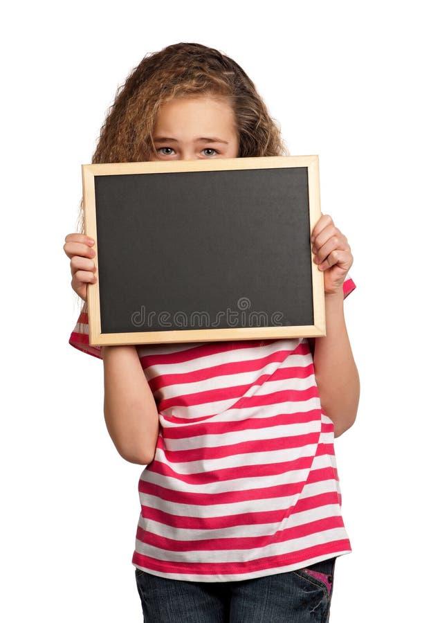 Muchacha con la pizarra foto de archivo libre de regalías