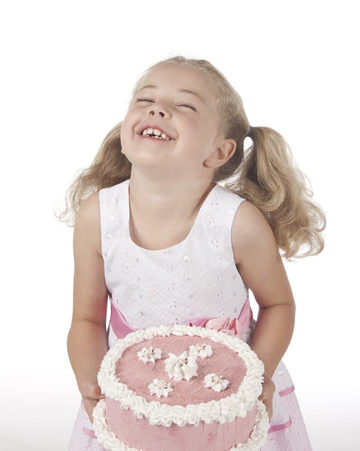 Muchacha con la torta fotografía de archivo libre de regalías