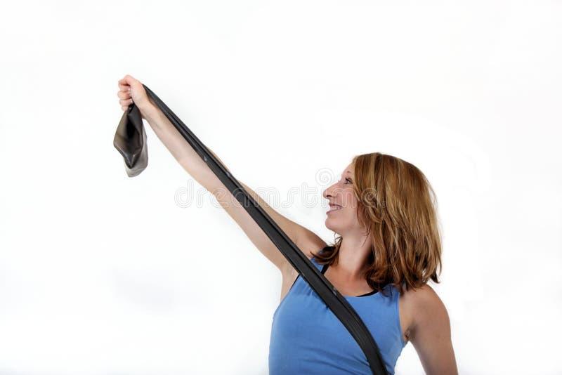 Muchacha con la venda del estiramiento foto de archivo