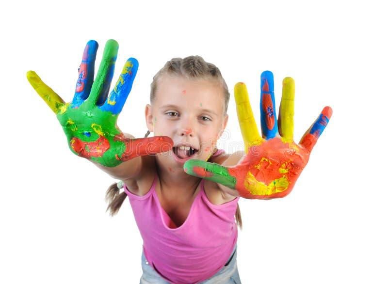 Muchacha con las palmas pintadas por una pintura. foto de archivo libre de regalías