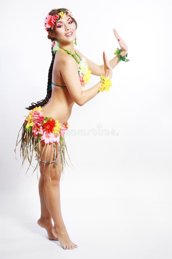 Muchacha con los accesorios hawaianos fotografía de archivo