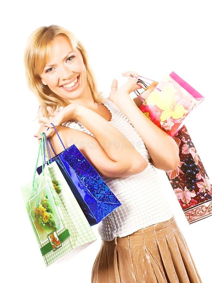 Muchacha con los bolsos de compras - sally fotografía de archivo