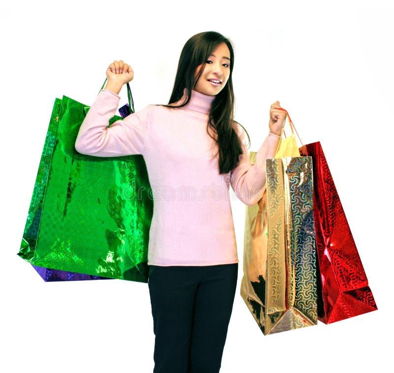 Muchacha con los bolsos del regalo fotos de archivo libres de regalías