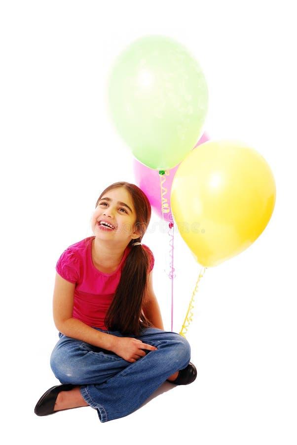 Muchacha con los globos fotografía de archivo
