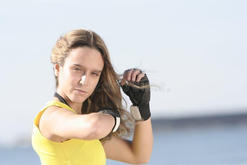 Muchacha con los guantes imagenes de archivo