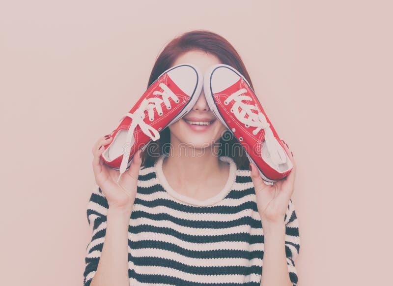 muchacha con los gumshoes fotos de archivo libres de regalías
