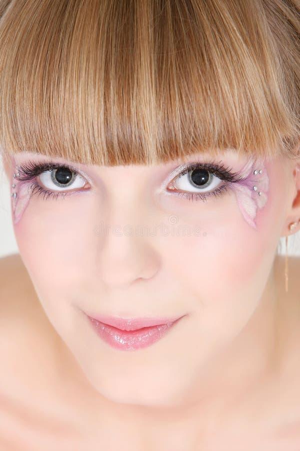 Muchacha con maquillaje floral imagenes de archivo