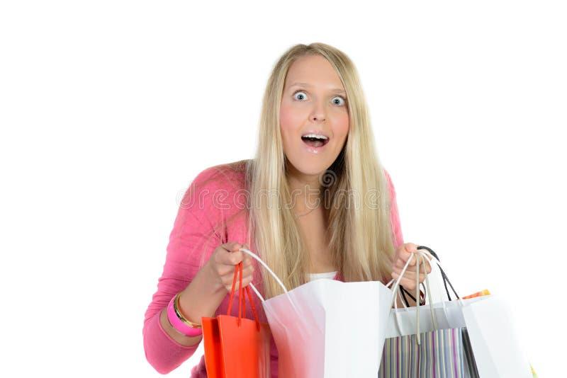 Muchacha con muchos bolsos de compras imágenes de archivo libres de regalías