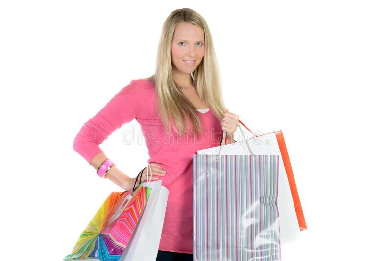 Muchacha con muchos bolsos de compras foto de archivo libre de regalías