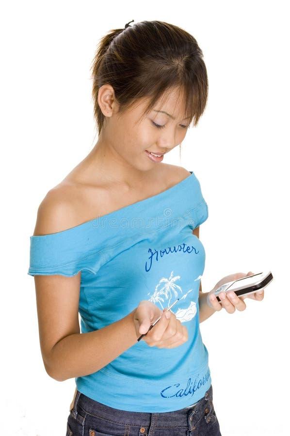 Muchacha con PDA foto de archivo libre de regalías