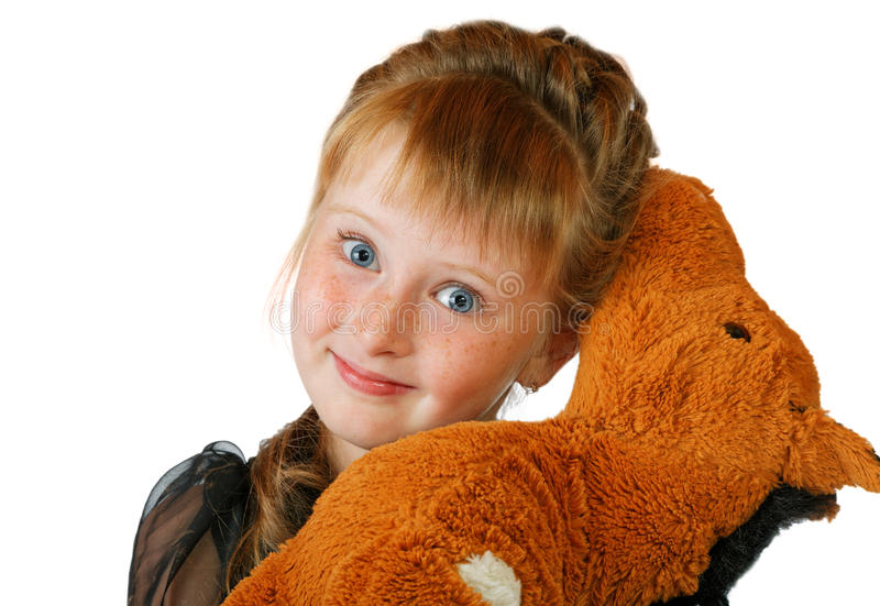 Muchacha con un juguete suave en un blanco fotografía de archivo libre de regalías